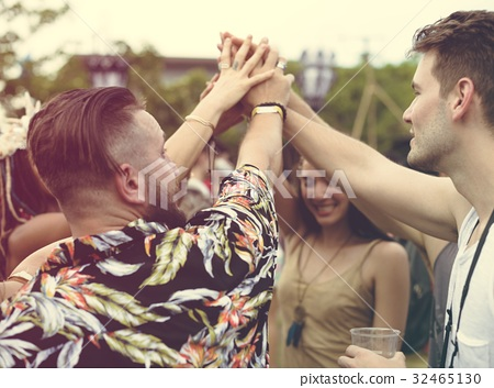 Friends Hands Together Unity at Festival Event - Stock Photo