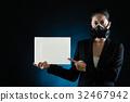 Asian woman wearing a mask presenting blank board 32467942