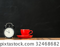 retro black alarm clock with red coffee cup set 32468682