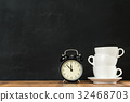 stacked white coffee cups with retro alarm clock 32468703