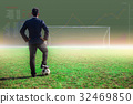 businessman with football in the stadium foolball. 32469850