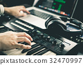 Music producer is recording sound on Computer 32470997