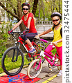 Family bike ride with rucksack cycling on bike 32475444