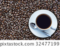 coffee cup and coffee beans 32477199