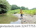 outing to the riverside, playing in a river, baby boy 32477755