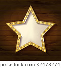 Gold star on wooden background. 32478274