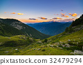 Colorful sunlight on the majestic mountain peaks. 32479294