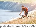 Traveler has adventur on meadow on riverside 32479597
