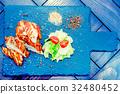 Grilled turkey fillet and vegetables in restaurant 32480452