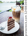 chocolate cake with cherry topping and ice coffee  32486364