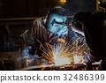 Team workers are welding part in factory 32486399