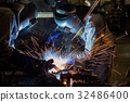 Team workers are welding part in factory 32486400