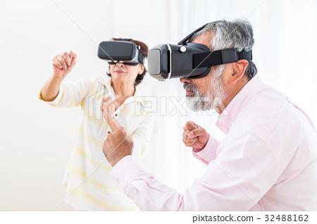 Senior virtual reality virtual reality enjoying VR - Stock