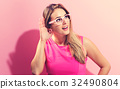 Young woman listening  32490804