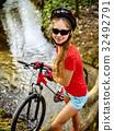 Bicycle teen with ladies bikes in summer park 32492791