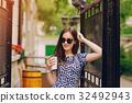 beautiful girl on the street 32492943
