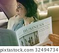 Photo Gradient Style with Businesswoman Reading Newspaper Car Inside 32494734