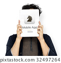 Man holding tablet cover his face about download chess game 32497264