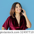 Woman standing and posing for photoshoot 32497710