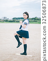 Female high school student who stands on pitching mound 32506873