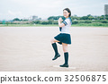 Female high school student who stands on pitching mound 32506875