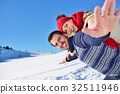 Loving couple playing together in snow outdoor. 32511946