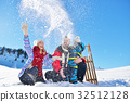 happy young family playing in fresh snow at 32512128