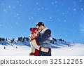 Happy couple playful together during winter 32512265