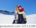 Loving couple playing together in snow outdoor. 32512286