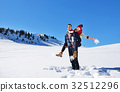 Loving couple playing together in snow outdoor. 32512296