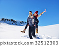 Loving couple playing together in snow outdoor. 32512303
