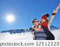 Loving couple playing together in snow outdoor. 32512320