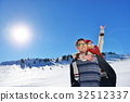 Loving couple playing together in snow outdoor. 32512337