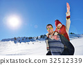 Loving couple playing together in snow outdoor. 32512339