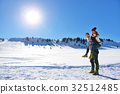 Loving couple playing together in snow outdoor. 32512485