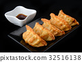 Deep fried gyoza crispy and golden colour. 32516138