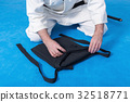 A martial arts master folding hakama 32518771