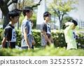 marathon runner, marathon, cloth bib with number or logo worn by athletes 32525572
