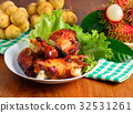 Grilled chicken and fruit on wooden background. 32531261
