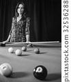 Beautiful woman at the pool table 32536288