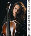 Attractive cello player and her instrument 32536290