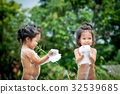 Two little girls having fun to play with water 32539685