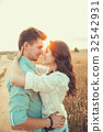 Young couple in love hugging outdoor in summer 32542931