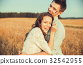 Young couple in love in field summer 32542955