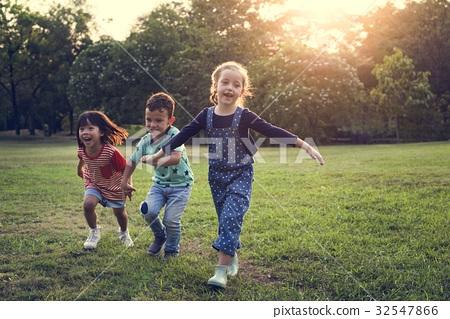 Children are in a field 32547866