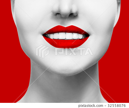 Close-up healthy smile of woman with red lips. 32558076