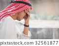 Arab Businessman is disappointed from losing 32561877