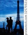Couple near the Eiffel tower in Paris 32570321