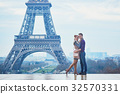 Couple near the Eiffel tower in Paris 32570331