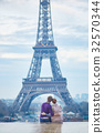 Couple near the Eiffel tower in Paris, France 32570344